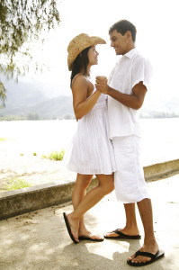 Romantic couple wearing white clothing.